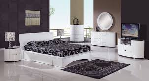 white bedroom furniture design. Contrasting Bedroom Design That Uses Modern White Sets Combined With Dark Brwon Walls Furniture