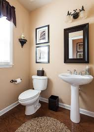 traditional powder room with hickory manor house beaded bracket shelf pedestal sink powder room hardwood floors