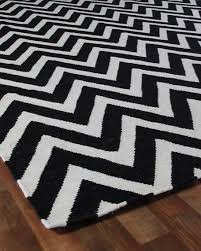 black and white chevron lines rug
