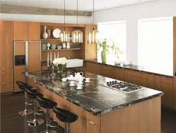 trendy kitchen design with a farmhouse sink flat panel cabinets medium tone wood cabinets