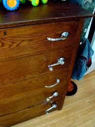 love this idea vine window handles car door handles as dresser handles add a little industrial look to a clic piece of furniture