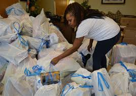 ashley cherry from east hills looks for a bag of toys during a gift give
