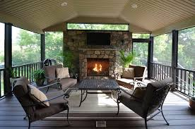 inside fully screened sheltered deck with custom fieldstone fireplace
