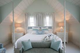 white and blue cottage bedroom with white seas nightstands