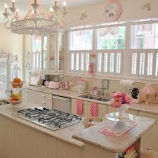 charming candy kitchen with marble countertop stove and chadelier with pink flower image