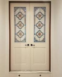 spanish star design quatrefoil traditional french doors leaded glass stained glass insulated unit art glass custom