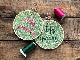 defying gravity embroidery hoop art