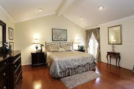 stylish bedroom designed with light wall colors and vaulted ceiling can lights for vaulted ceilings remodel