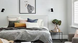 white bedroom with ter cushions