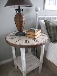 i pried them apart and with a finishing nailer attached them to the side of the table top the hoop edge was then finished off with a dark stain and
