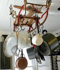 hanging pot holder hanging pot rack from an old sled great way to diy hanging flower hanging pot holder