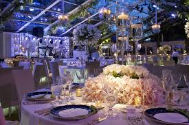 floating candles for pool wedding. tent wedding reception table with floating candles and white centerpiece for pool