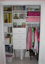 interior floating white wooden closet shelves with white wooden drawer also brown rod with
