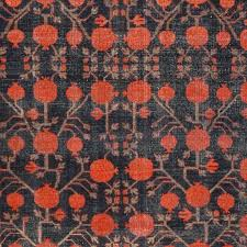 antique rugs from the city of khotan have a style that is all their own