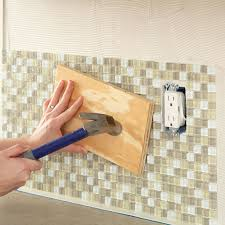 install tile backsplash seat tiles firmly in the mastic by tapping a board