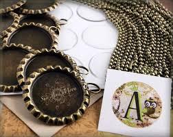 the sun and moon antique bronze bottle cap pendant kit makes 20 bottle cap pendants