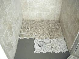 pebble stone shower floor pictures shows rounded river rocks in a installation installers floors for tiled