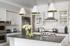 white kitchen cabinets with concrete countertops