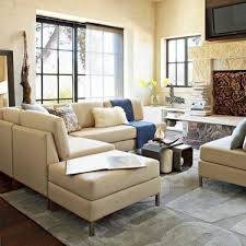 low seating furniture living room. image of magnificent living room sectionals covered by cream linen upholstery fabric using white fur throw low seating furniture