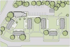 a site plan showing the community center in relation to the apartment buildings on the