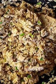 the fried rice being stir fried in a wok