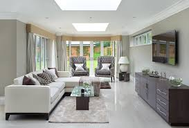 This Contemporary Living Room Brings Together Neutral Colors And Elegant  Gray Floors Under Two Square Skylights
