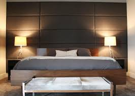 full size gray leather upholstered headboard wall panel combined with white shade table lamp on black solid wood bed side table as well as silk upholstered