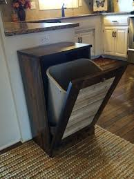 tilt out rustic cabinet with a trash can hidden inside