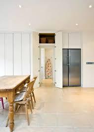 hidden door kitchen. white trimmed dining room with the hidden door kitchen n