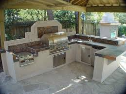 kitchen l shaped outdoor kitchen dimensions white concrete flooring raw exposed beam ceiling stainless steel