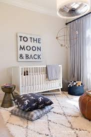 white and blue boy nursery with dwellstudio mid century crib