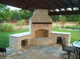 outside kitchen with grill and stone corner fireplace under the roof outdoor kitchen corner fireplaces fireplaces and grilling