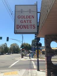 golden gate donuts a greasy spoon in oakland s temescal neighborhood is where people congregate the walls are pink the 1 refills sign is hand drawn and