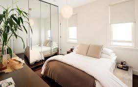Large Mirror In Bedroom Large Mirrors In A Small Bedroom With White Walls And Table Lamps