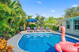 villa tropicana near pga blvd with a large heated private pool