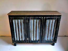 rustic bar cabinet with reclaimed corrugated metal inserts
