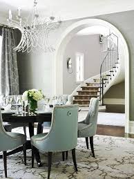 this dining room chairs wall color and framed staircase through the archway beautiful gracious family home traditional home fabric colors