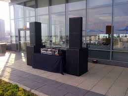 stage speakers setup. dj setup on a rooftop patio at the corus entertainment complex. jbl srx series speakers stage i