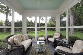 Sun room with many windows and garden view