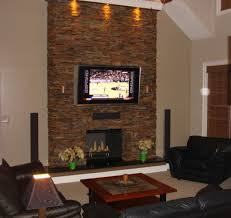 wall fireplace with tv surface stone veneer fireplace brown tile