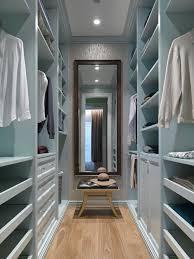 Small transitional gender-neutral medium tone wood floor and brown floor  walk-in closet