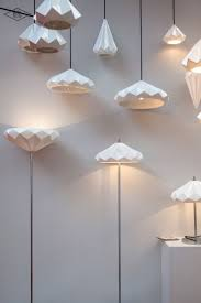 the angular surfaces of the fixture reflect light in varying ways if you re