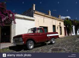 old ford pickup truck on historic paved spanish street with high ...