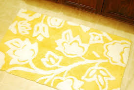 yellow bath towels and rugs