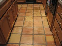 before picture of dirty saltillo tiles that have lost their re