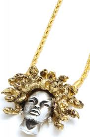 the medusa pendant necklace in silver gold