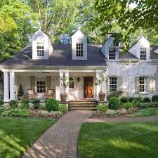 Love the whitewashed brick + dormer windows + porch (so I can overlook the  asymmetrical design)