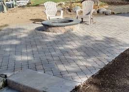 permeable paver patio with raised firepit
