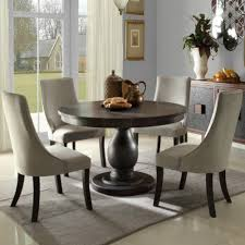 hit dining room furniture small dining room. Good Looking Small Dining Room Decoration Ideas Using White Velvet Distressed Wood Chairs Including Light Gray Rug Under Table And Round Hit Furniture