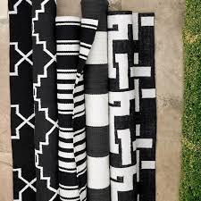 white striped rug navy blue black